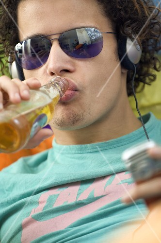 Youth drinking beer and listening to music
