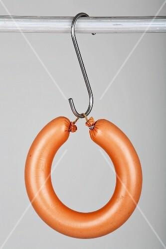 A ringwurst (Lyoner) on a hook