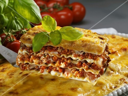 A portion of lasagne on a palette knife
