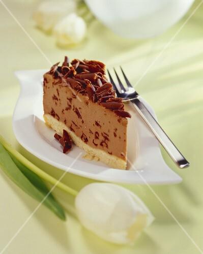 Piece of hazelnut chocolate cheesecake with grated chocolate