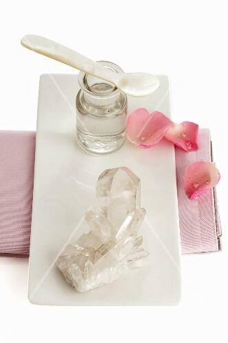 Quartz crystals, apothecary bottle and flower petals