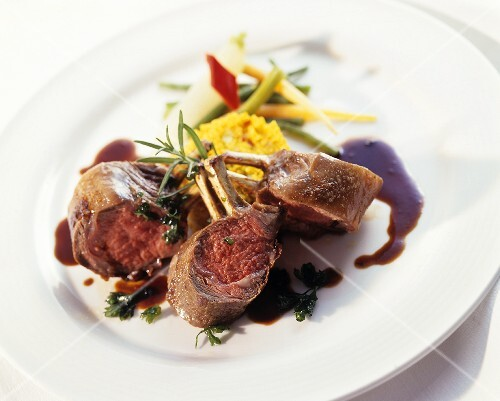 Pieces of rack of lamb with saffron couscous and vegetables