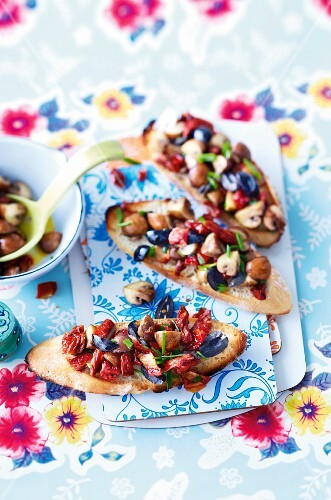 Bruschetta with dried tomatoes, mushrooms and olives