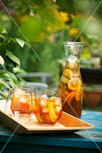 Punch in glasses and a carafe in the open air