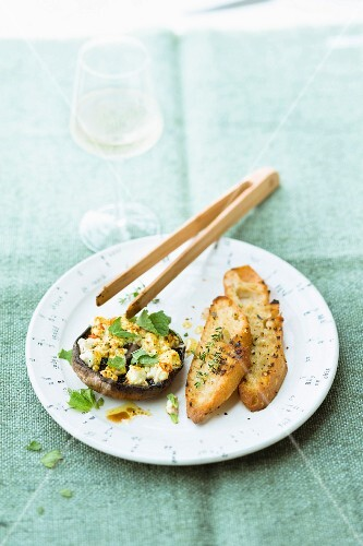 A Portobello mushroom filled with sheep's cheese and mint served with garlic bread