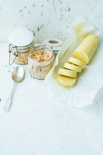 Jars of tomato and pepper butter and a roll of orange-curry butter