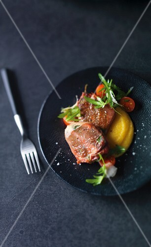 Stuffed veal medallions with apricots, Parma ham and sage