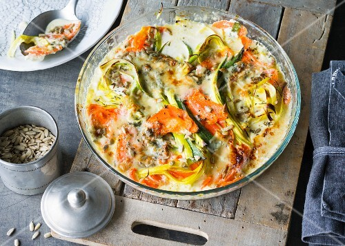 Carrot and blue cheese gratin with leek and sunflower seeds