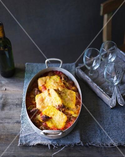 Polenta gratin with sausage