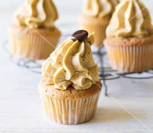 Coffee cupcakes with buttercream and mocha beans