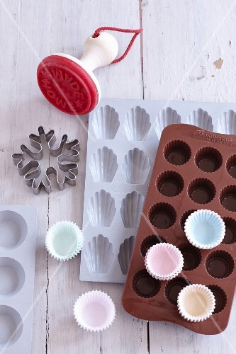 A biscuit cutter, silicon baking moulds and paper cases