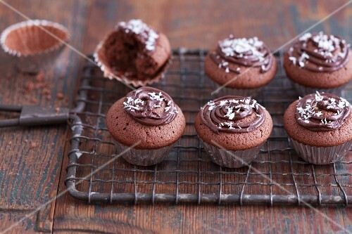 Chocolate cupcakes made with espresso and coconut in metal baking tins