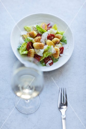 Gnocchi with cos lettuce, dried tomatoes and Parmesan