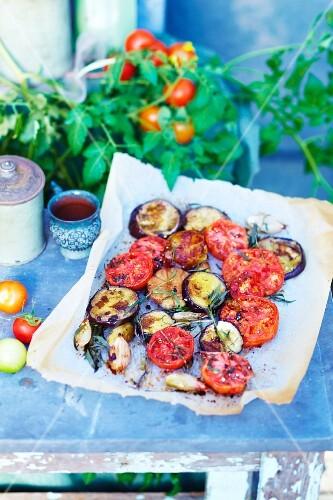 Oven-baked summer vegetables on baking paper