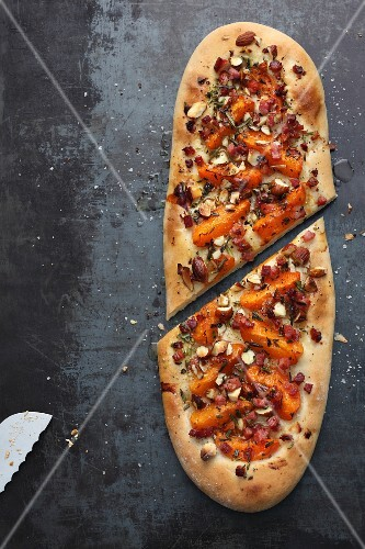 Focaccia with apricots, bacon and hazelnuts (seen from above)