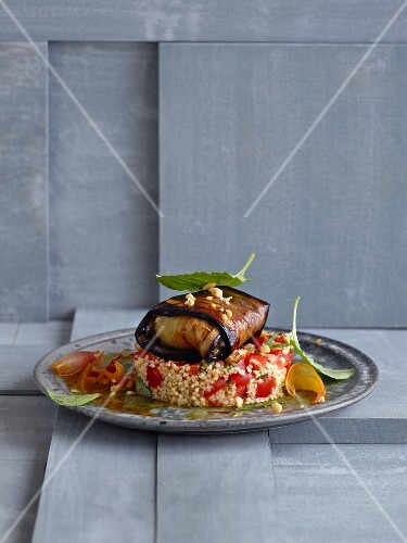 Aubergine parcels filled with feta, pine nuts and dates