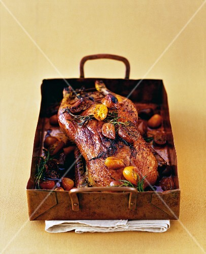 Crispy duck with a honey crust served with kumquats and figs