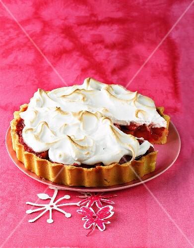 Rhubarb meringue tart on a red plate