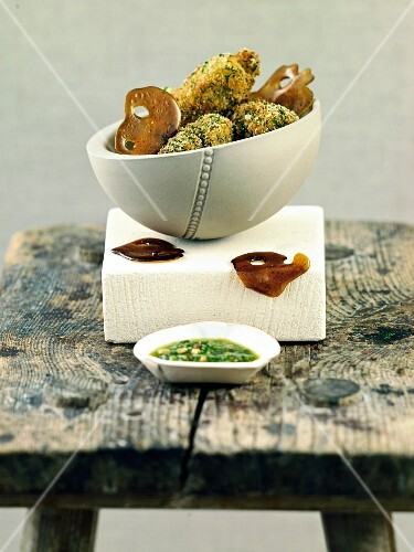 Baked, herb coated cheese cubes with sweet pesto