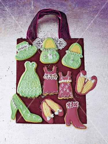 Pink and green fashion biscuits shaped like handbags, dresses and shoes