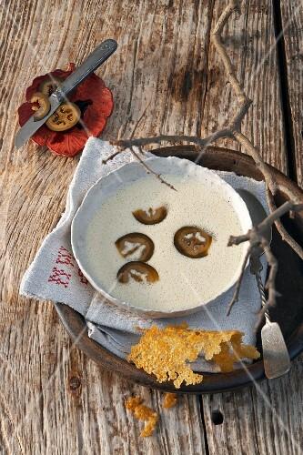 Parmesan soup with black walnuts