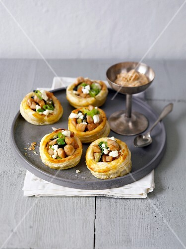 Puff pastry vol-au-vents filled with chicken, aubergine, feta and a peanut dip