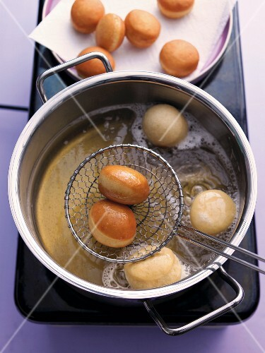 Mini doughnuts being fried