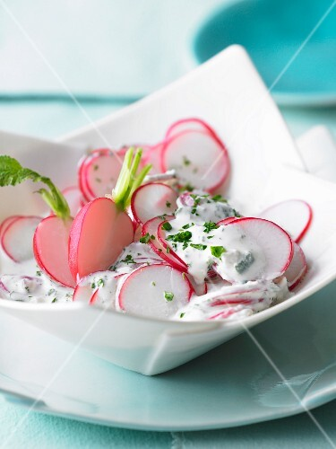 Close-up of radish salad with goat cheese in bowl