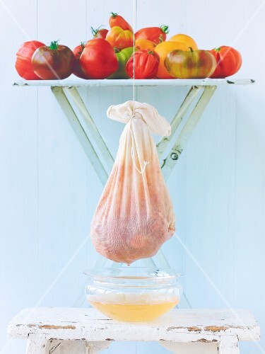 Tomato water being made: tomatoes draining