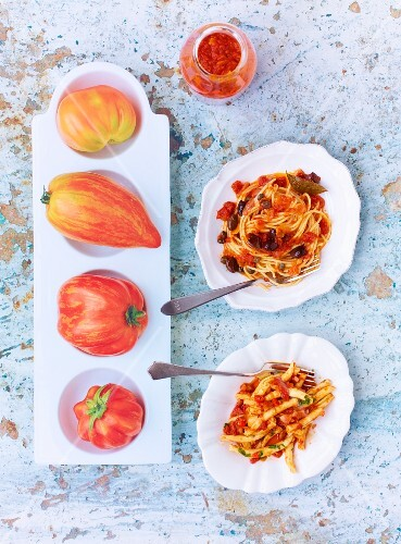 Pasta with various tomato sauces: spaghetti with puttanesca sauce and macaroni al arrabbiata
