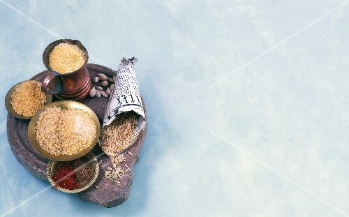 Ingredients for Oriental cuisine: bulgur, couscous, rice, cardamom and saffron