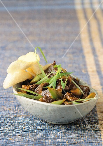 Beef with spring onions and krupuk (Bail, Indonesia)