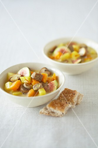 Lamb stew with figs, pumpkin and mushrooms