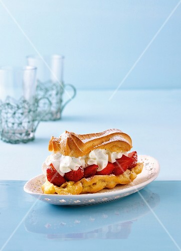 An eclair with strawberries and cream