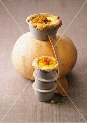 Mini pumpkin pies with ginger in ramekins