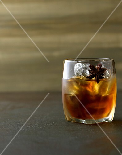 A maple and cardamom Old Fashioned: cocktail with whiskey, anise and maple syrup
