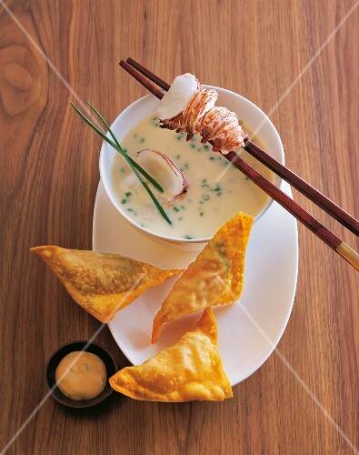 Eel soup with lobster and won-tons with a vegetable filling