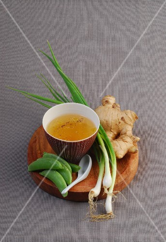 Ingredients for oriental soup: stock, vegetables and ginger