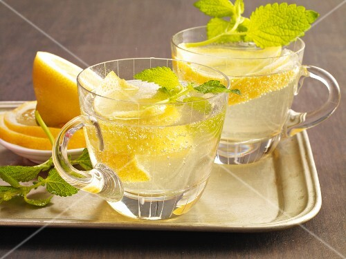 Two glasses of Cold Duck with lemon and mint