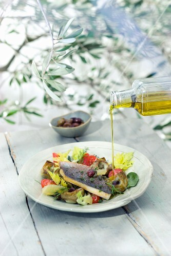 Sea bream with an artichoke salad, olives, tomatoes and capers