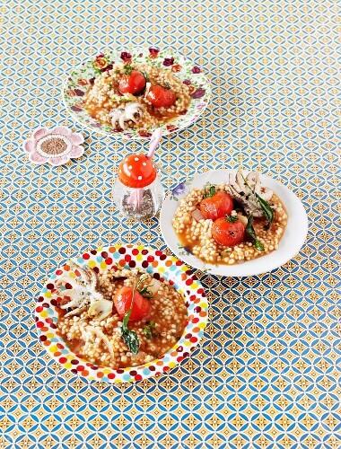 Tomato risotto with calamaretti and sage