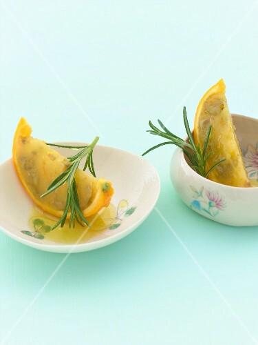 Olive-orange sorbet in orange wedges