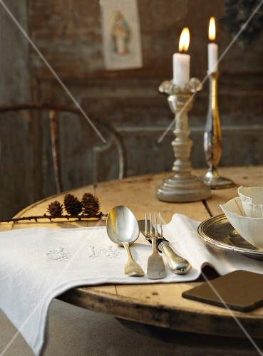 A table laid in a country house-style with burning candles