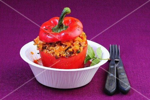 A red pepper filled with rice and minced meat