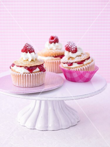 Raspberry mascarpone cupcakes on a cake stand
