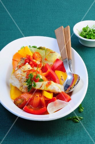 Warm fish salad with peppers and a saffron dressing