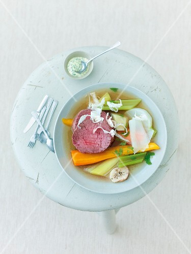 Bowl of boeuf a la ficelle with dip