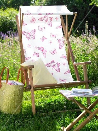 Charmant Close Up Of Deck Chair With Butterfly Pattern And Sun Canopy