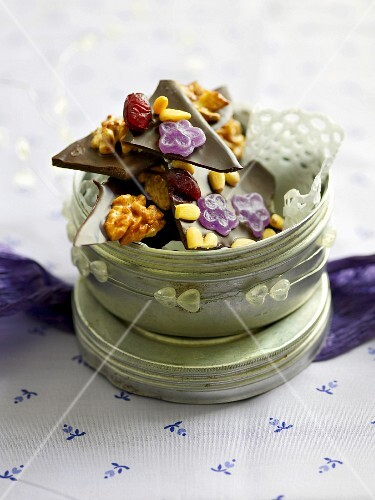 Chocolate with violets, nuts, cranberries and pine nuts