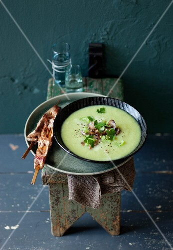 Cream of Brussels sprouts and celery soup served with lamb skewers